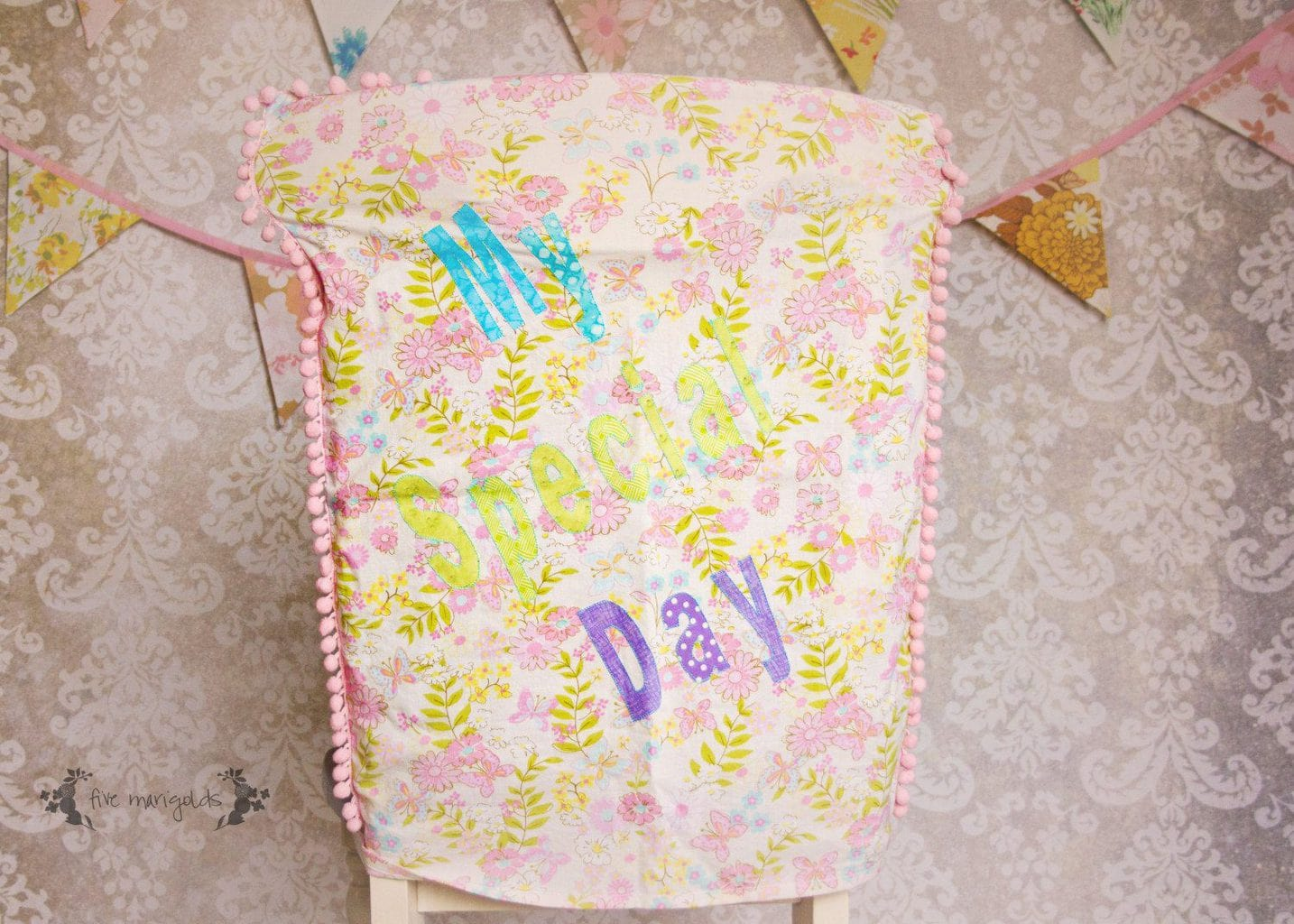 Baby Girl Bow Birthday Party Chair Cover | Five Marigolds