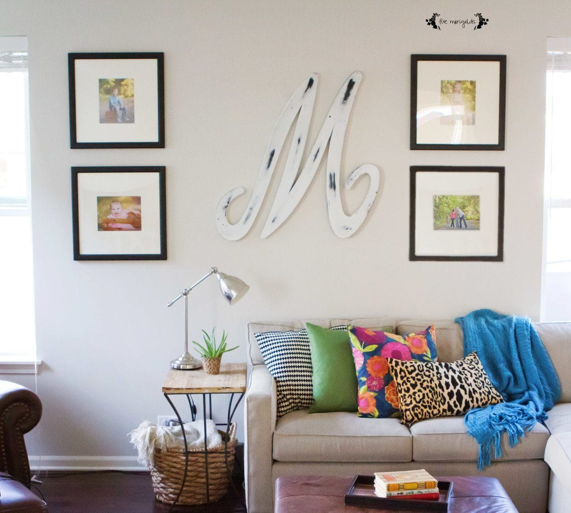 Living Room with bright pillows and symmetrical wall gallery | Five Marigolds
