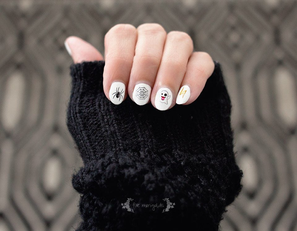 Great idea! Printable nail art using Halloween themed emojis!
