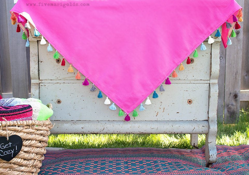 Tutorial for turning a dollar store tablecloth into a custom memory blanket for gatherings.
