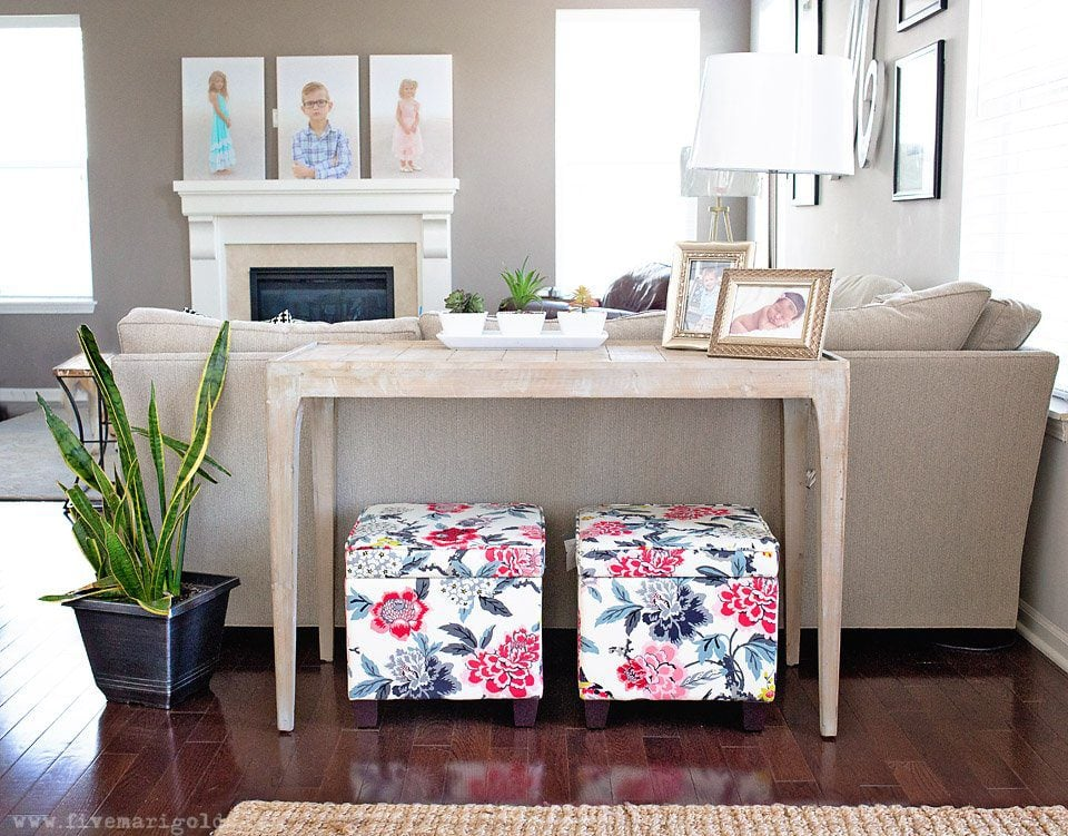 Tips for creating a beautiful and comfortable living space on a budget: custom photo canvases, faux mosaic tile and vintage fabrics and prints.