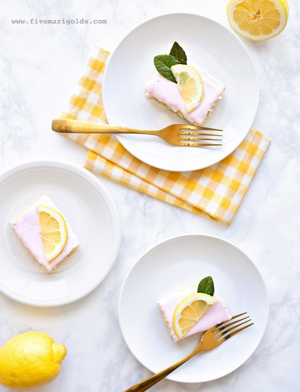 Sheet Cake with pink frosting and lemon slices
