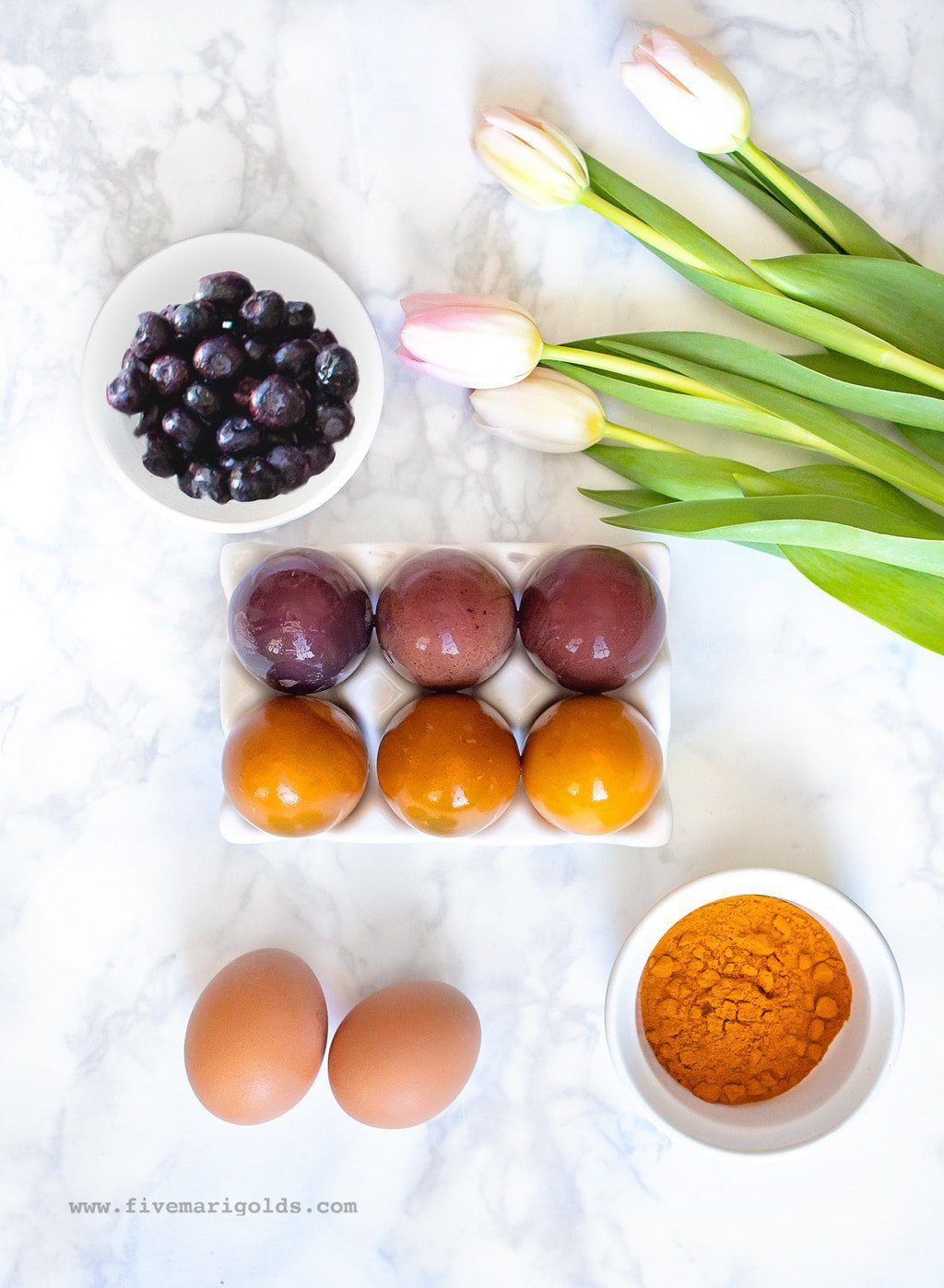 Naturally dye brown easter eggs with blueberries and turmeric